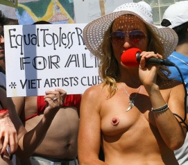 Woman protesting with nipple-shaped pasties.